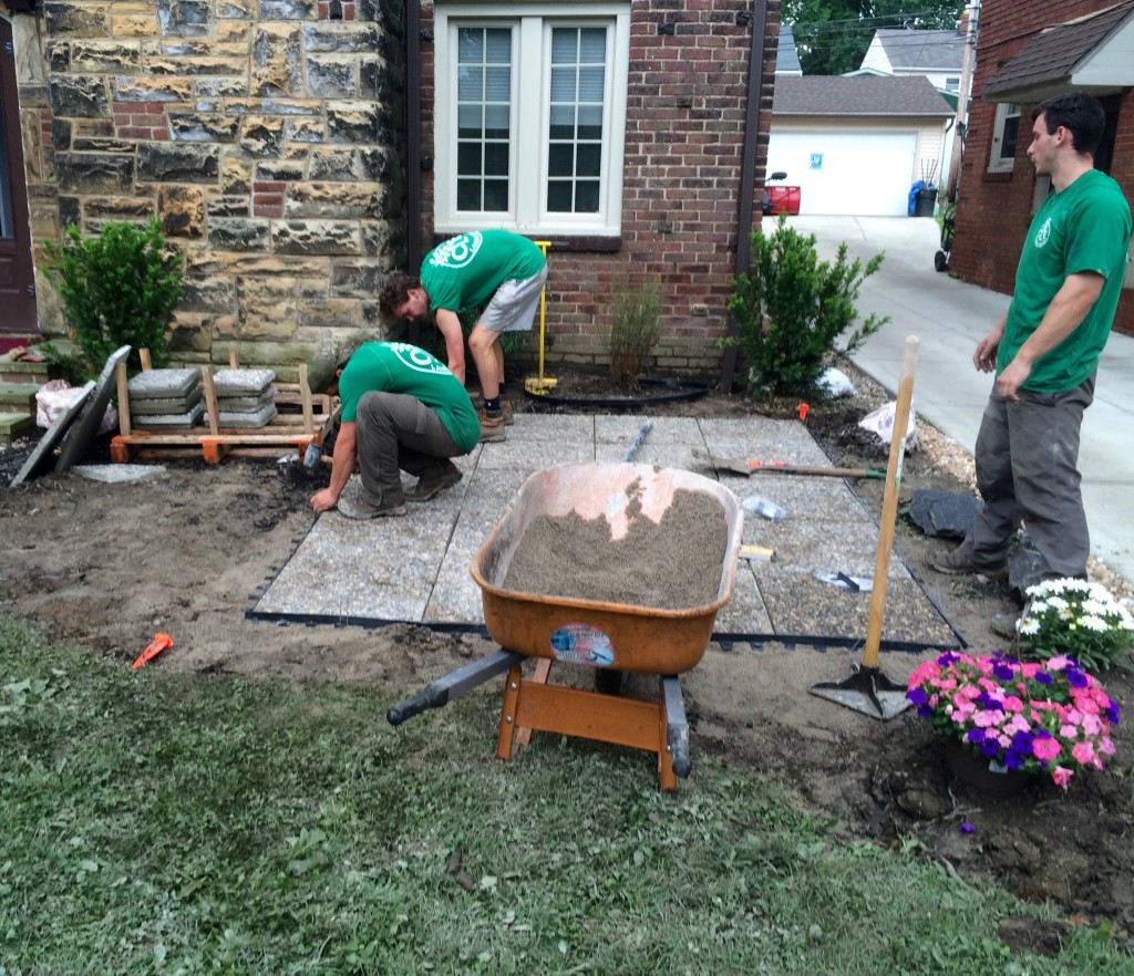 Progress: Design layout determined. Area excavated. Base material added. Pavers installed and secured with edging.