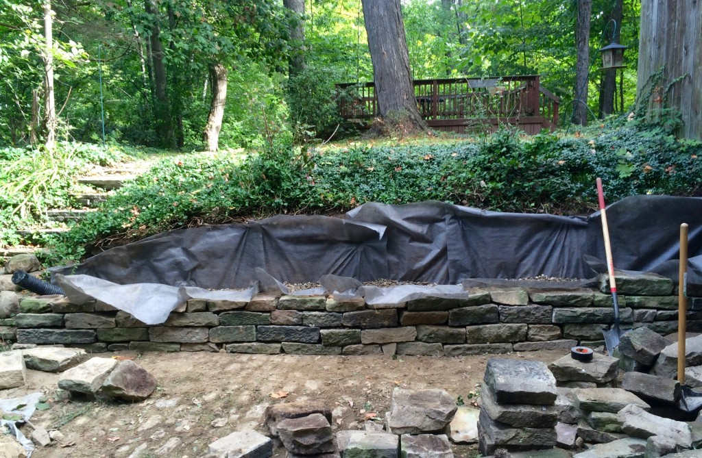 Flagstone retaining wall rebuild progress.