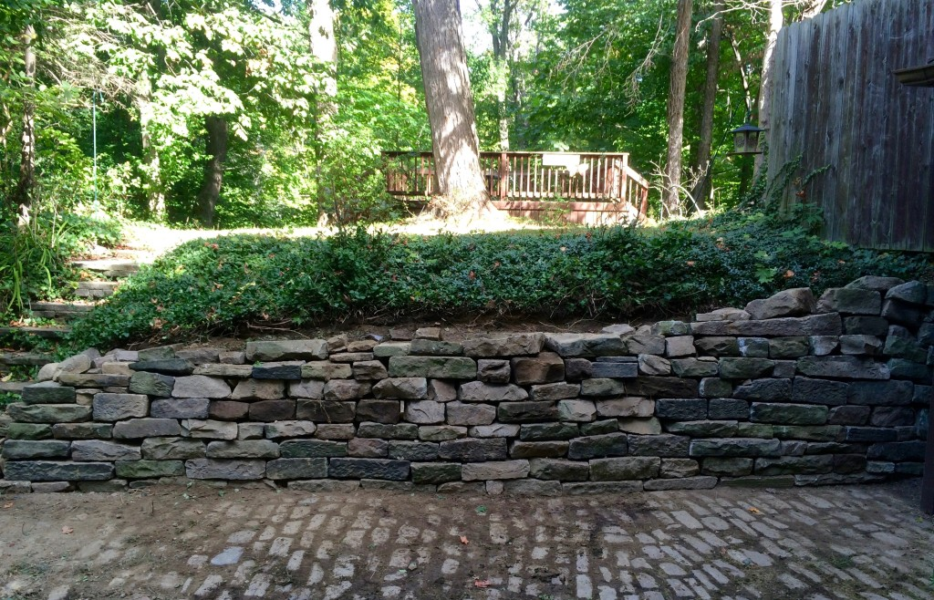 Flagstone retaining wall rebuild complete.